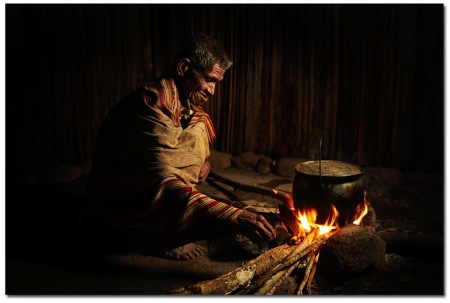 Timorese elder by the fire, taken with the help of a transmitter an off camera flash, a gel and a softbox.