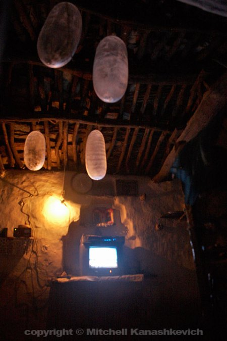 Floating condoms/baloons and some entertainment technology in our friend's stone and mud home