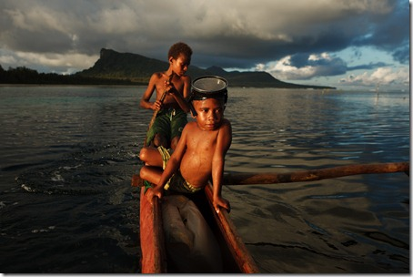 children in a canoe-lagoon-Rah Lava-Banks-Vanuatu
